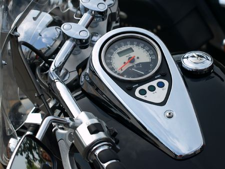 Shine motorcycle speedometer closeup with red needle.