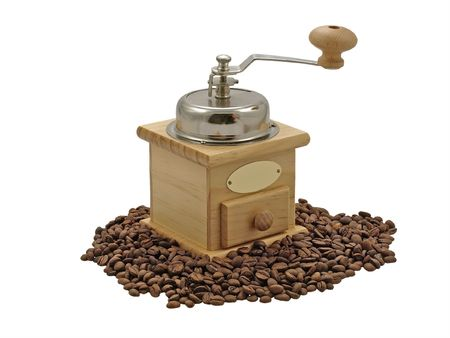 Manual coffee grinder and coffee beans on a white background. photo