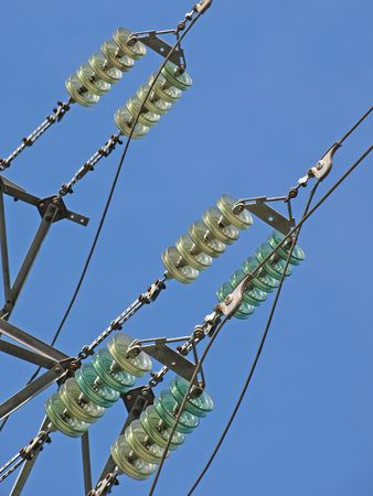 isolator insulator: High voltage electrical insulator electric line against the  blue sky.