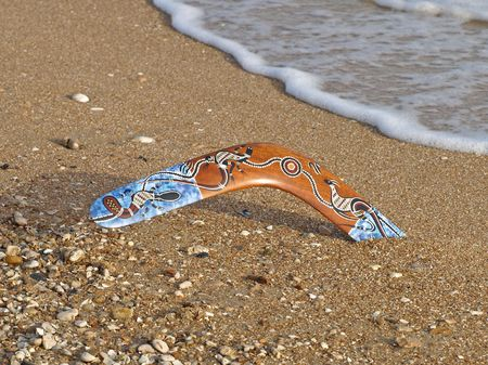 australian outback: Colorful boomerang on a sandy beach