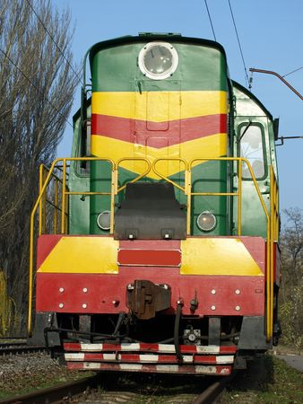 The locomotive on the rails.