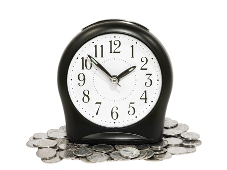 Black clock and coins isolated on white background.