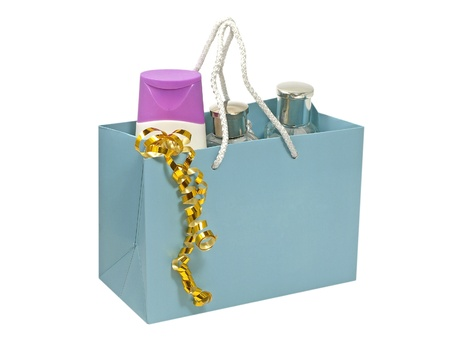 Gift set in blue gift bag with isolated on a white background Stock Photo