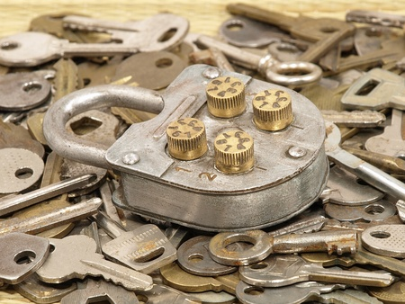 Oldl lock on a metal keys background. photo