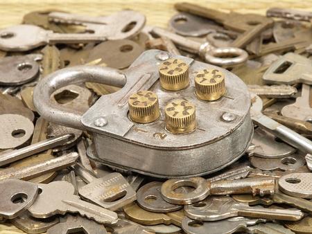 Oldl lock on a metal keys background. photo