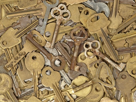 Old metal keys as background. photo