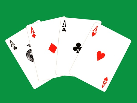 Four ase isolated on a green background. photo