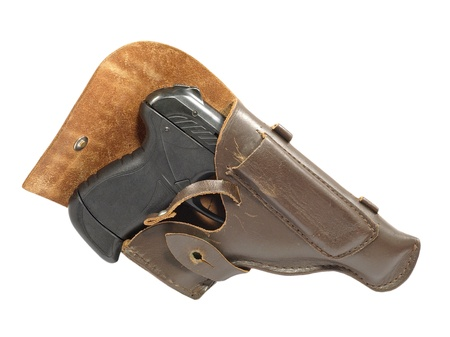 holster: Black pistol in holster isolated on a white background.