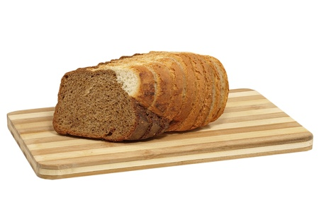 Fresh sliced bread on cutting board isolated on a white background.
