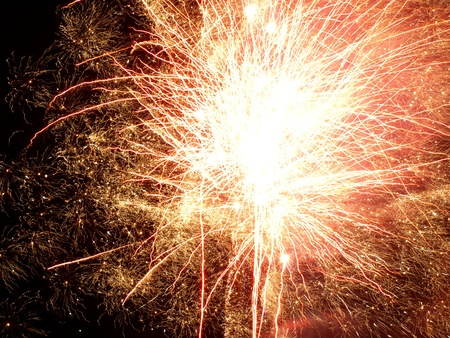 Shining Fireworks Bursts in a Darkness as Abstract Background. Stock Photo