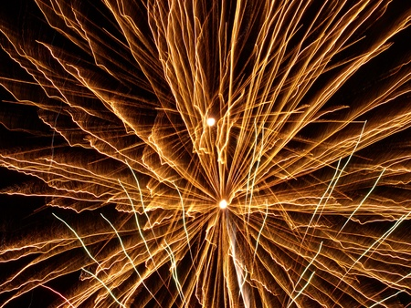 Golden Fireworks Bursts in a Darkness as Abstract Background.