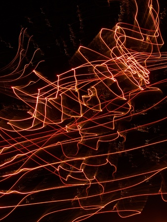Shining Multicolored Lines in a Darkness as Abstract Background. Stock Photo
