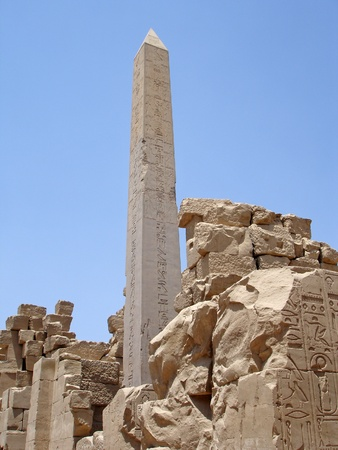 obelisk stone: Obelisk on  blue sky background in the Karnak temple. Stock Photo