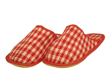 Red checkered house slippers isolated on a white background. Stock Photo