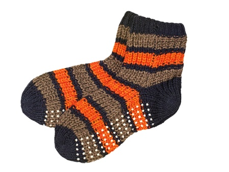 Pair of woolen striped socks isolated on the white background