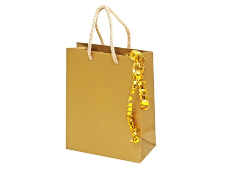 Gift bag and decorative golden tape isolated on white background. photo