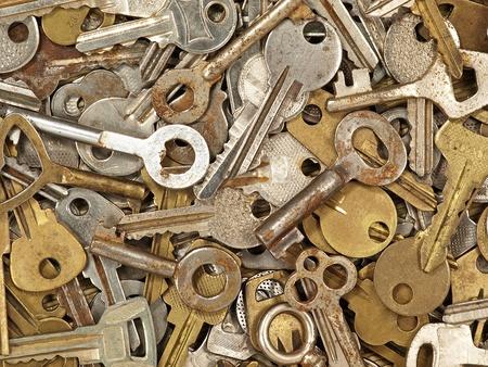 A lot of old metal keys taken closeup as background. photo