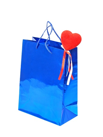 A Valentines Day holiday gift bag with red heart isolated on a white background. photo
