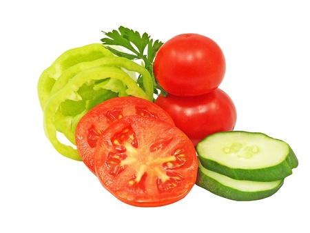 Ripe sliced cucumber, green pepper and tomatoes isolated on white background. photo