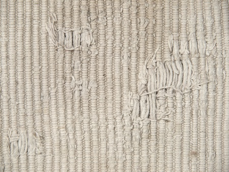 The rough  dirty knit fabric texture pattern as abstract background. photo