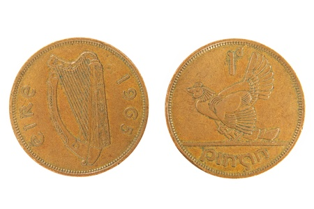 Old Irish monet one penny isolated on white background. photo