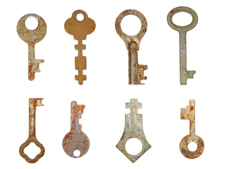 Set old rusty keys isolated on white background. photo