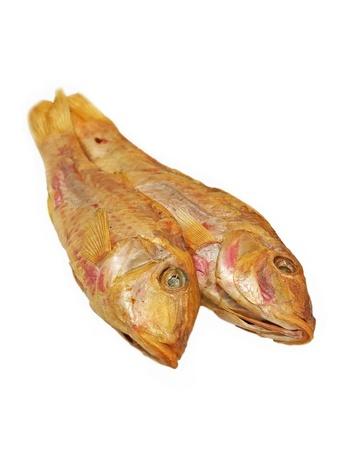 Dried goatfish taken closeup isolated on a white background  photo