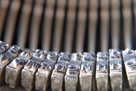 Symbols of old typewriter taken closeup. photo
