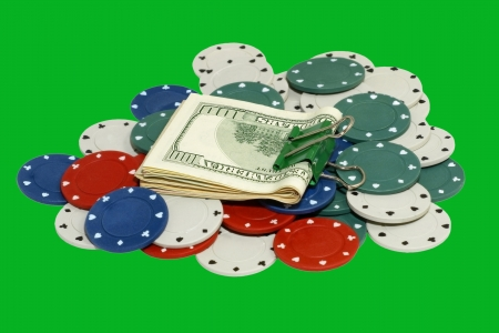 Dollar pack on a casino chips isolated on green background. photo