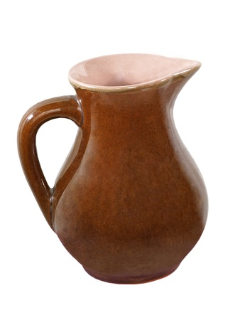 loamy: Brown ceramic jug taken closeup isolated on white background.