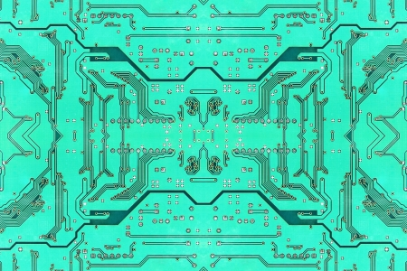 Green symmetrical electronic microcircuit taken closeup suitable as background. photo