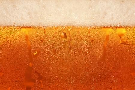 Beer foam in glass taken closeup as background. Stock Photo - 17246321