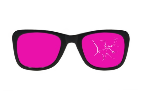 Broken pink glasses taken closeup isolated on white background. photo
