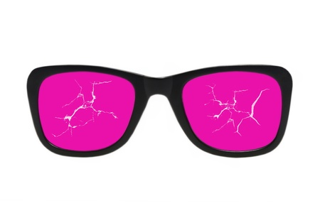 Cracked pink glasses isolated on a white background. photo