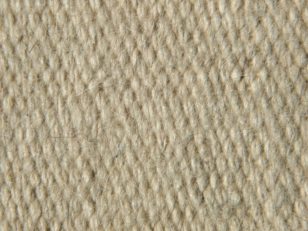 Rough beige camel wool fabric texture taken closeup as background. photo