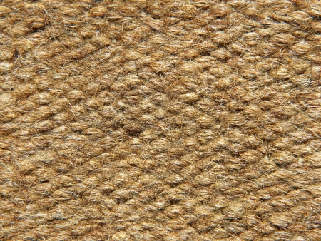 Rough brown camel wool fabric texture taken closeup as background. photo