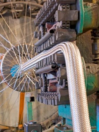 Flexible metal hose production line.Braiding machine taken closeup.