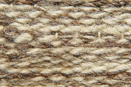 Rough camel wool fabric texture taken closeup as background. photo