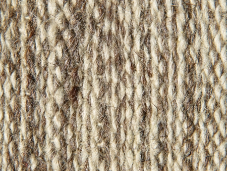 Rough knit camel wool fabric texture pattern as background. photo