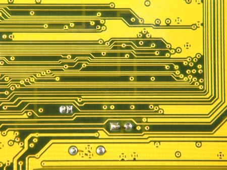 detail internet computer: Yellow electronic microcircuit taken closeup suitable as background.