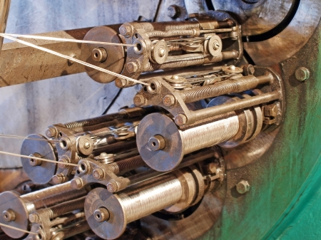 braiding: Flexible metal hose production line.Detail of braiding machine taken closeup. Stock Photo