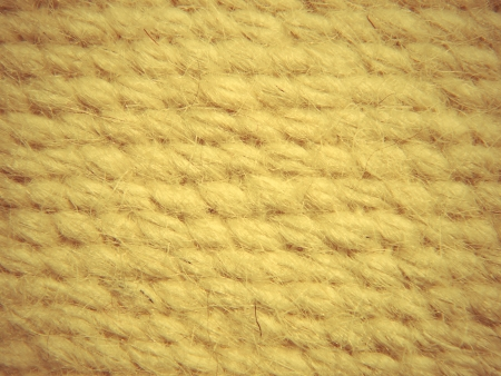 Rough camel wool fabric texture pattern taken closeup as background  photo