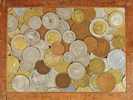 numismatic: Old wooden frame with numismatic coins collection inside as abstract background  Stock Photo