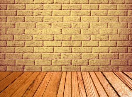 Indoor background with yellow brick wall and wooden plank floor taken closeup  photo