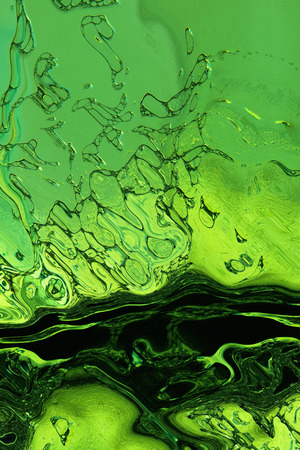 digitally generated image: Stylized green liquid texture as abstract background Digitally generated image  Stock Photo