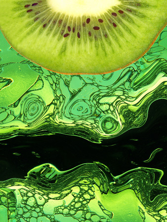 digitally generated image: Kiwi slice taken closeup on green abstract background Digitally generated image