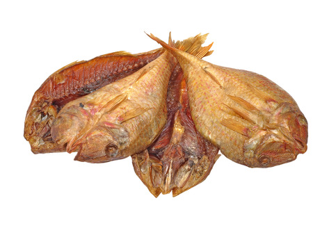 The heap of dried goatfish taken closeup isolated on white background. photo