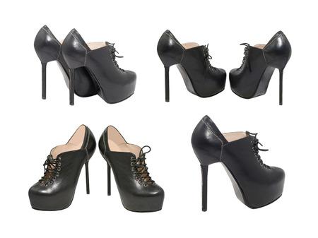 Set of high-heeled black shoes isolated on white background. photo