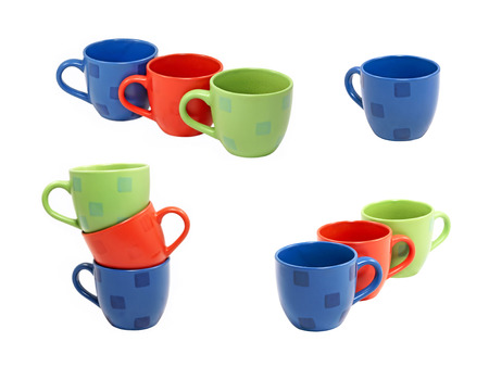 Multicolored tea cups set isolated on white background. photo