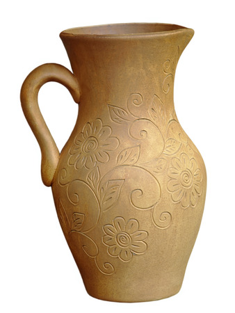 loamy: Old ceramic jug taken closeup isolated on white background.